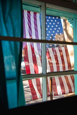 American flag hanging outside window