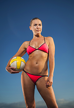 Confident Caucasian woman holding volleyball