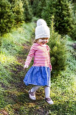 Caucasian girl walking on path