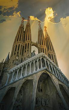 Sunbeams shining on towers of church
