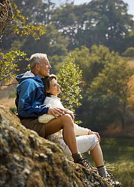 Couple sitting on rocks and relaxing