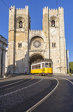 The yellow tram number 28 close to the ancient Cathedral (Se), Alfama district, Lisbon, Portugal, Europe