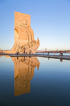 Sunset on the Padrao dos Descobrimentos (Monument to the Discoveries) reflected in Tagus River, Belem, Lisbon, Portugal, Europe