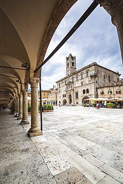 The old arcades frame the historical buildings of Piazza del Popolo, Ascoli Piceno, Marche, Italy, Europe