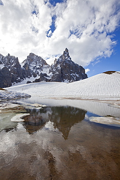 Thawing snow leaving some puddles at the foot of the Pale di San Martino by San Martino di Castrozza, Dolomites, Trentino, Italy, Europe