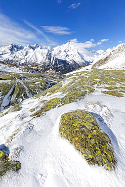 Sunshine and snow at Alpe Fora with Monte Disgrazia in the background, Malenco Valley, Province of Sondrio, Valtellina, Lombardy, Italy, Europe