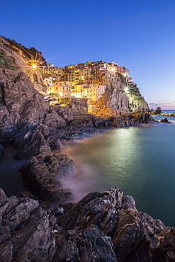 Blue hour in the little village of Manarola with its pastel coloured houses in the Cinque Terre National Park, UNESCO World Heritage Site, Liguria, Italy, Europe