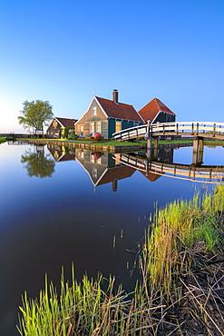 Blue dusk on wooden houses of the typical village of Zaanse Schans framed by River Zaan, Zaanse Schans, North Holland, The Netherlands, Europe