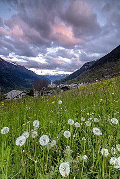 Clouds at dawn on the alpine village of Soglio, Maloja, Bregaglia Valley, Engadine, Canton of Graubunden, Switzerland, Europe