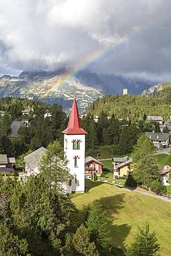 Rainbow over Chiesa Bianca, Maloja, Bregaglia Valley, Engadine, Canton of Graubunden (Grisons), Switzerland, Europe