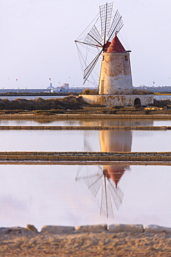 Windmill reflected in the salt flats, Saline dello Stagnone, Marsala, province of Trapani, Sicily, Italy, Mediterranean, Europe