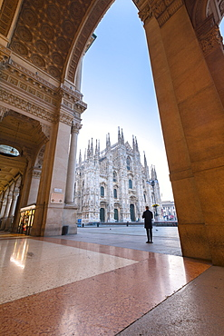 Man looks towards Milan Cathedral (Duomo) from Galleria Vittorio Emanuele II, Milan, Lombardy, Italy, Europe
