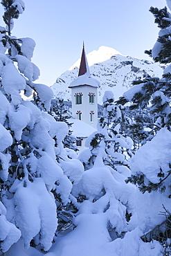 Snow covered trees around Chiesa Bianca, Maloja, Bregaglia Valley, Engadine, Canton of Graubunden, Switzerland, Europe