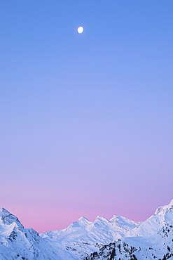Sunrise on the snowy peaks of Val Maroz, Bregaglia Valley, Engadine, Canton of Graubunden, Switzerland, Europe