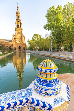 Old tower seen from the decorated ceramics balustrade along the canal, Plaza de Espana, Seville, Andalusia, Spain, Europe