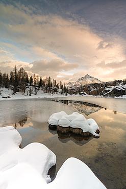 Snow on Lake Mufule by Sasso Moro in Sondrio, Italy, Europe