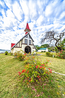 Clouds over the red roof of Notre Dame Auxiliatrice Church, Cap Malheureux, Mauritius, Indian Ocean, Africa