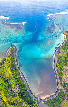 Coastal road facing the turquoise lagoon, aerial view by drone, Bel Ombre, Baie Du Cap, South Mauritius, Indian Ocean, Africa