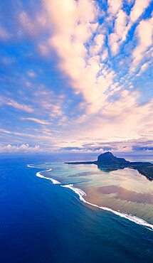 Sunrise over Le Morne and coral reef in the turquoise lagoon, aerial view by drone, Baie Du Cap, South Mauritius, Indian Ocean, Africa