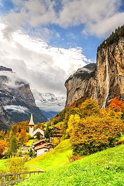 Alpine village of Lauterbrunnen and Trummelbach Falls cascade in autumn, canton of Bern, Bernese Oberland, Switzerland, Europe