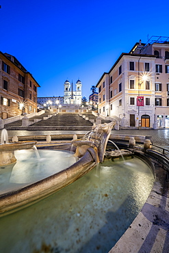 Piazza di Spagna (Spanish Steps), Barcaccia fountain and Trinita dei Monti at dusk, Rome, Lazio, Italy, Europe
