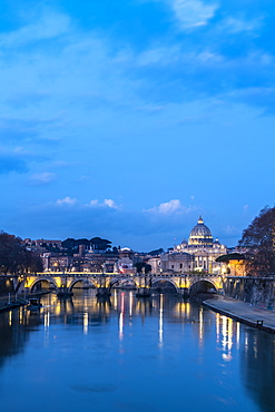 River Tiber with Umberto I Bridge and St. Peter's Basilica (Basilica di San Pietro) in background at dusk, Rome, Lazio, Italy, Europe