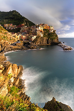 Waves crashing on cliffs next to Manarola, Cinque Terre, UNESCO World Heritage Site, La Spezia province, Liguria, Italy, Europe