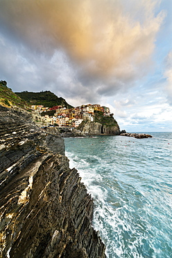 Waves crashing on cliffs at sunset, Manarola, Cinque Terre, UNESCO World Heritage Site, La Spezia province, Liguria, Italy, Europe