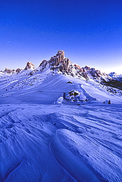 Starry sky at dusk on Ra Gusela mountain surrounded by fresh snow, Giau Pass, Dolomites, Belluno province, Veneto, Italy, Europe