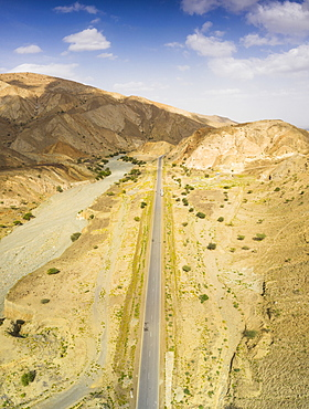 Panoramic view by drone of straight empty road through Danakil desert, Afar Region, Ethiopia, Africa