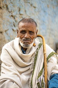 Portrait of Ethiopian senior man with traditional clothing and stick, Abala, Afar Region, Ethiopia, Africa