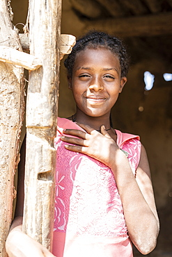 Little girl smiling from hut in Abala village, Afar Region, Ethiopia, Africa