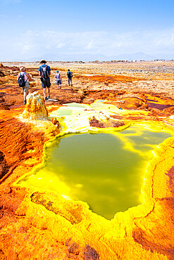 Tourists looking at hot springs and sulphur ponds, Dallol, Danakil Depression, Afar Region, Ethiopia, Africa