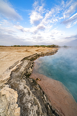 Steam rising from the hot water of Ala Lobet (Alol Bet) geyser, Semera, Afar Region, Ethiopia, Africa