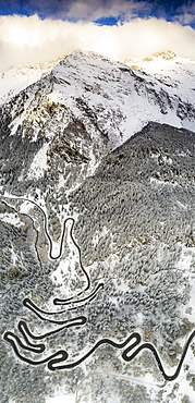 Bends of Maloja Pass road on snowy mountain ridge, aerial view, Bregaglia Valley, Engadine, canton of Graubunden, Switzerland, Europe