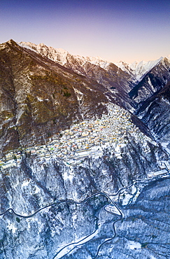 Aerial panoramic by drone of Premana village during winter dusk, Valsassina, Lecco province, Lombardy, Italy, Europe