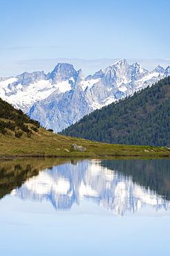 Piz Badile and Cengalo reflected in Porcile Lakes, Val Lunga, Tartano Valley, Valtellina, Sondrio province, Lombardy, Italy, Europe