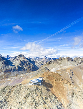 Aerial by drone of clear sky over Piz Nair and cable car station on top, Engadine, canton of Graubunden, Switzerland, Europe