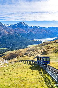 Chantarella-Corviglia funicular traveling uphill with St. Moritz lake in background, Engadine, canton of Graubunden, Switzerland, Europe