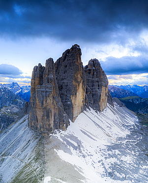 Clouds over the majestic peaks of Tre Cime di Lavaredo, aerial view, Sesto Dolomites Natural Park, South Tyrol, Italy, Europe