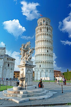 Tourists admiring the Renaissance fountain and the Leaning Tower of Pisa in summer, UNESCO World Heritage Site, Pisa, Tuscany, Italy, Europe