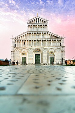 Romanesque facade of Pisa Cathedral (Duomo) under romantic sky at sunrise, Piazza dei Miracoli, UNESCO World Heritage Site, Pisa, Tuscany, Italy, Europe