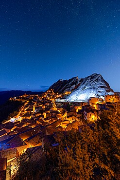 Stars in the night sky over the medieval town of Pietrapertosa, Dolomiti Lucane, Potenza province, Basilicata, Italy, Europe