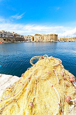 Fishing nets in the harbor surrounded by old town and castle by the sea, Gallipoli, Lecce province, Salento, Apulia, Italy, Europe
