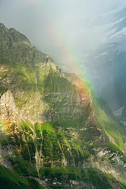 Rainbow over the majestic Wetterhorn mountain in summer, aerial view, Grindelwald, Bernese Alps, Canton of Bern, Switzerland, Europe
