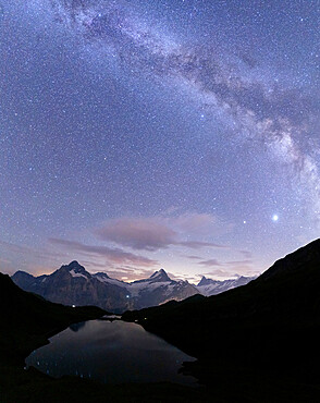 Milky Way over Bachalpsee lake on a summer night, Grindelwald, Jungfrau Region, Bernese Oberland, Canton of Bern, Switzerland
