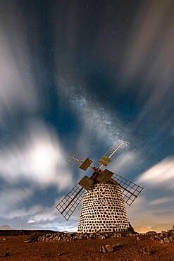Long exposure image of clouds in the night sky over the old windmill, La Oliva, Fuerteventura, Canary Islands, Spain - 1179-5098