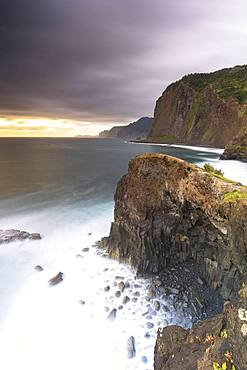 Storm clouds over the Atlantic Ocean and cliffs at dawn, Madeira island, Portugal