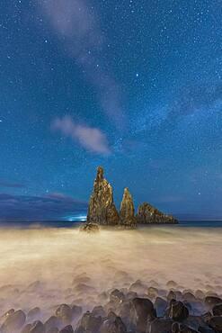 Waves crashing over Ilheus da Rib and Ribeira da Janela rock formations under the starry night sky, Madeira, Portugal, Atlantic, Europe