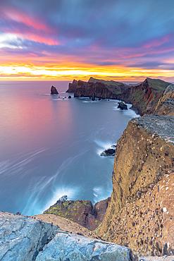Waves crashing on cliffs at dawn, Ponta Do Rosto, Sao Lourenco Peninsula, Canical, Madeira island, Portugal